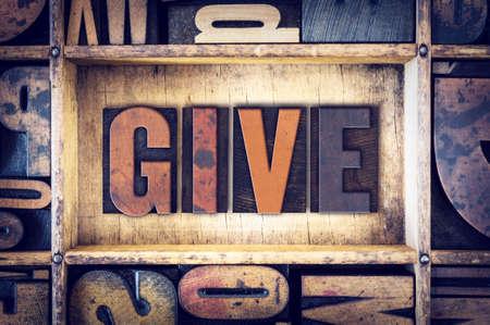 endow: The word Give written in vintage wooden letterpress type.