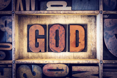 jesus word: The word God written in vintage wooden letterpress type. Stock Photo