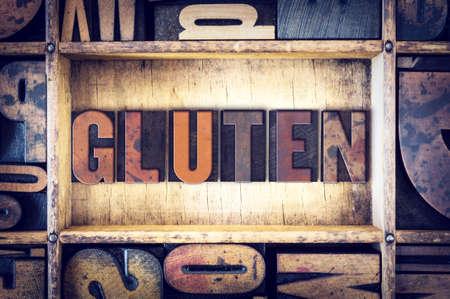 letterpress type: The word Gluten written in vintage wooden letterpress type.