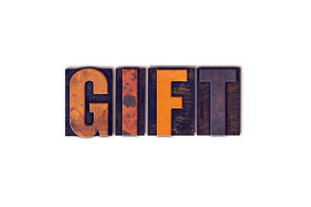 The word Gift written in isolated vintage wooden letterpress type on a white background.