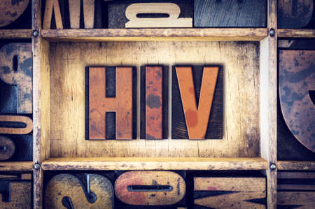 sexually transmitted disease: The word HIV written in vintage wooden letterpress type.