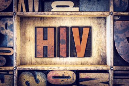 letterpress type: The word HIV written in vintage wooden letterpress type.