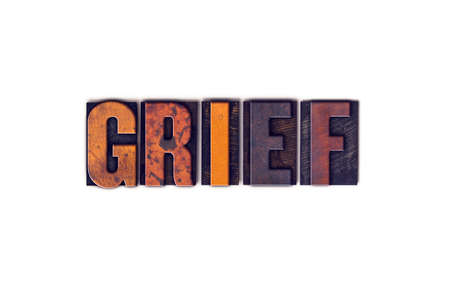 The word Grief written in isolated vintage wooden letterpress type on a white background.