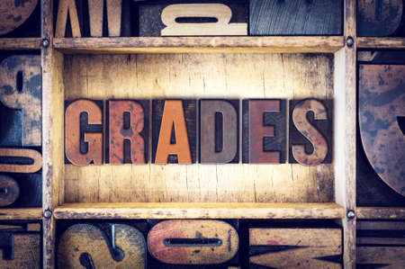grades: The word Grades written in vintage wooden letterpress type. Stock Photo