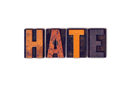 The word Hate written in isolated vintage wooden letterpress type on a white background.