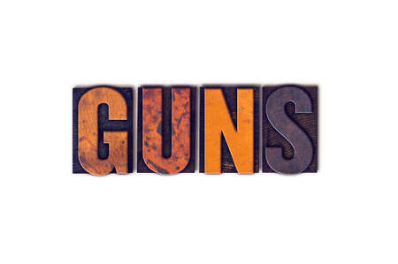 muzzleloader: The word Guns written in isolated vintage wooden letterpress type on a white background. Stock Photo