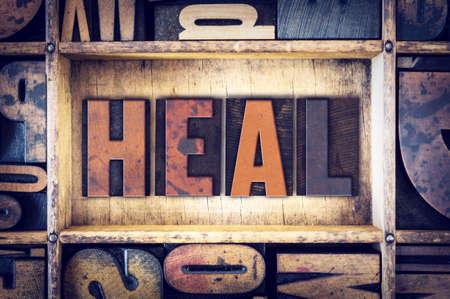 The word Heal written in vintage wooden letterpress type.