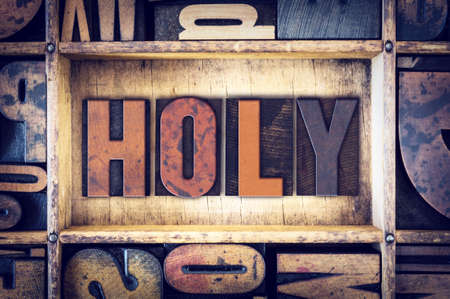 sanctified: The word Holy written in vintage wooden letterpress type.
