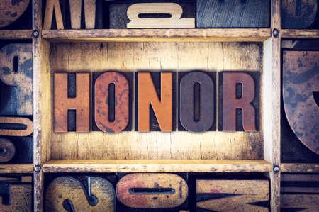 letterpress type: The word Honor written in vintage wooden letterpress type.