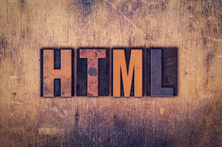 html: The word HTML written in dirty vintage letterpress type on a aged wooden background.