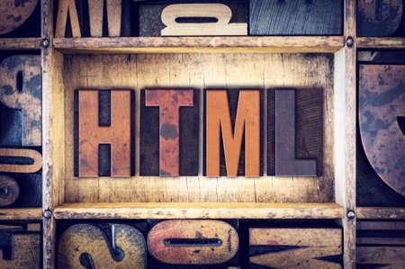 html: The word HTML written in vintage wooden letterpress type.