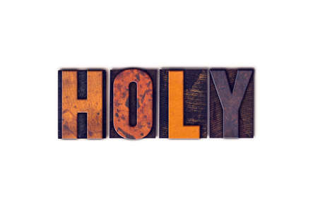 sanctified: The word Holy written in isolated vintage wooden letterpress type on a white background. Stock Photo