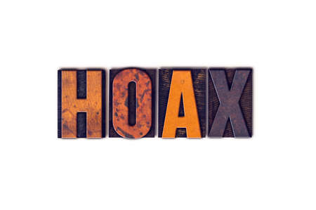 forgery: The word Hoax written in isolated vintage wooden letterpress type on a white background.