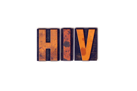 The word HIV written in isolated vintage wooden letterpress type on a white background.