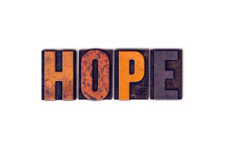 """La palabra """"esperanza"""", escrita en el tipo de tipografía de madera aislada de la vendimia en un fondo blanco. Foto de archivo"""