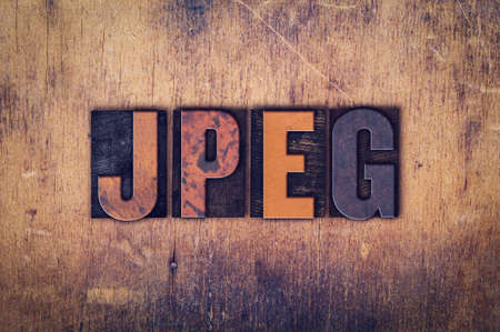 jpeg: The word JPEG written in dirty vintage letterpress type on a aged wooden background.