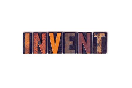 """Het woord """"Invent"""" geschreven in geïsoleerde vintage houten boekdruk letters op een witte achtergrond. Stockfoto"""