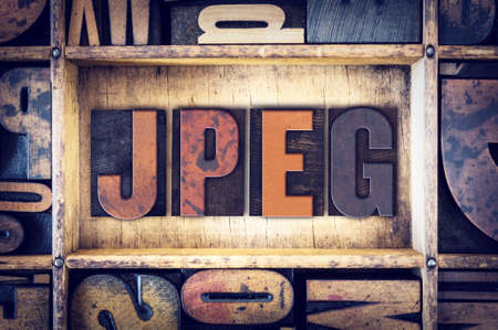 letterpress: The word JPEG written in vintage wooden letterpress type.