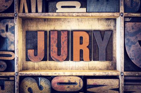 testimony: The word Jury written in vintage wooden letterpress type.