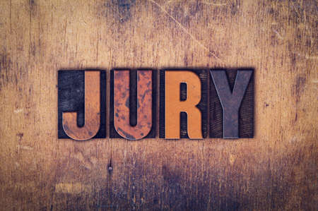 sentence typescript: The word Jury written in dirty vintage letterpress type on a aged wooden background.