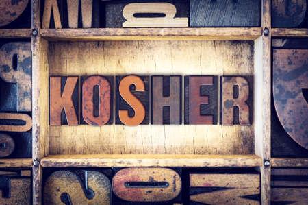 letterpress type: The word Kosher written in vintage wooden letterpress type.