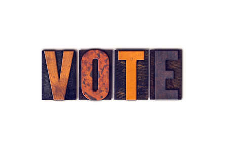 voting booth: The word Vote written in isolated vintage wooden letterpress type on a white background.