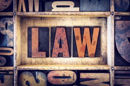 """edicto: La palabra """"Ley"""", escrito en tipografía de madera de la vendimia."""