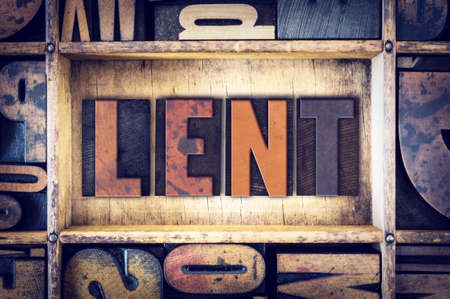 The word Lent written in vintage wooden letterpress type. Stock Photo