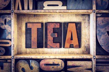 letterpress type: The word Tea written in vintage wooden letterpress type.
