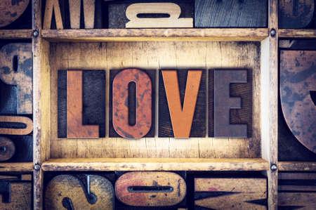 The word Love written in vintage wooden letterpress type.