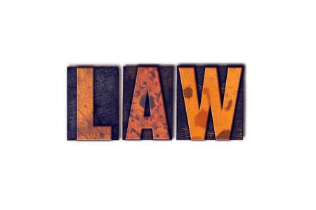 """edicto: La palabra """"Ley"""" escrita en el tipo de tipografía de madera aislada de la vendimia en un fondo blanco. Foto de archivo"""