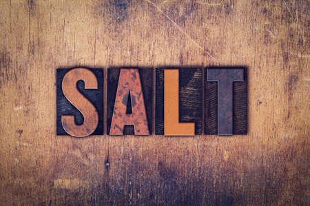 The word Salt written in dirty vintage letterpress type on a aged wooden background. Reklamní fotografie