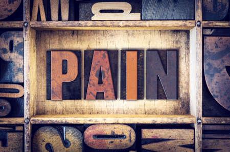pain killers: The word Pain written in vintage wooden letterpress type.
