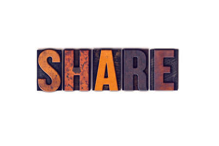 shared sharing: The word Share written in isolated vintage wooden letterpress type on a white background.