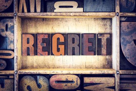 remorse: The word Regret written in vintage wooden letterpress type. Stock Photo