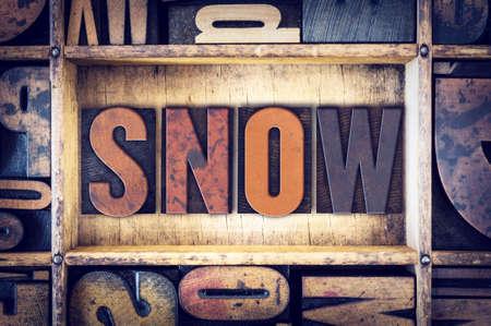 letterpress type: The word Snow written in vintage wooden letterpress type.