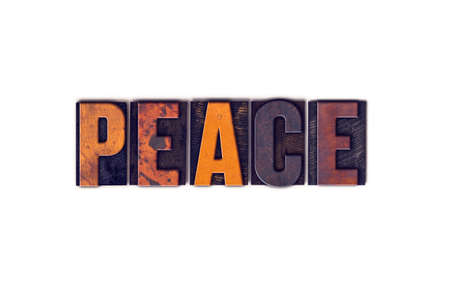 ceasefire: The word Peace written in isolated vintage wooden letterpress type on a white background.