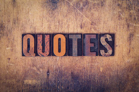 spoken: The word Quotes written in dirty vintage letterpress type on a aged wooden background. Stock Photo