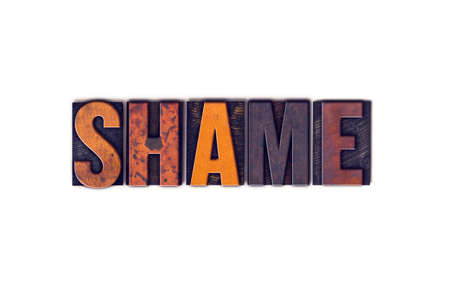 disgrace: The word Shame written in isolated vintage wooden letterpress type on a white background.