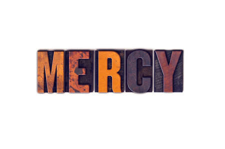 forgiven: The word Mercy written in isolated vintage wooden letterpress type on a white background.