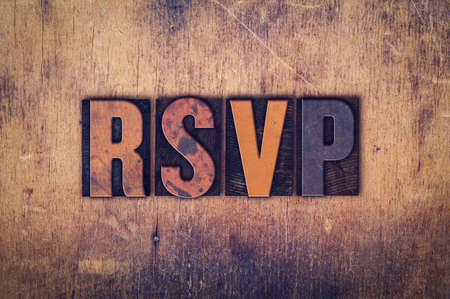 rsvp: The word RSVP written in dirty vintage letterpress type on a aged wooden background.
