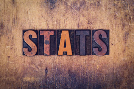 The word Stats written in dirty vintage letterpress type on a aged wooden background. Stock Photo