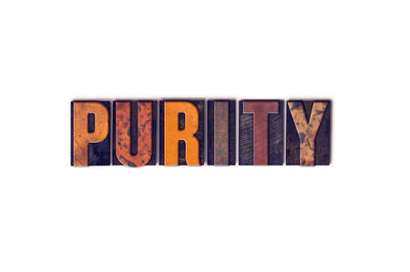unblemished: The word Purity written in isolated vintage wooden letterpress type on a white background. Stock Photo