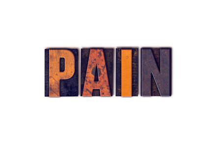 pain killers: The word  Pain written in isolated vintage wooden letterpress type on a white background.