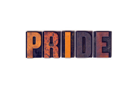 The word Pride written in isolated vintage wooden letterpress type on a white background.