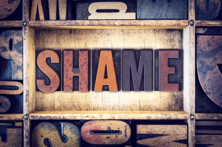 shaming: The word Shame written in vintage wooden letterpress type.