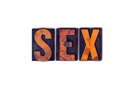 The word Sex written in isolated vintage wooden letterpress type on a white background.