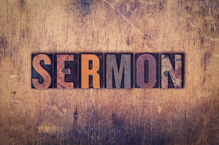 sermon: The word Sermon written in dirty vintage letterpress type on a aged wooden background. Stock Photo