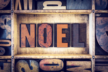 hymn: The word Noel written in vintage wooden letterpress type.