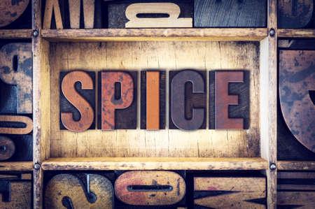 letterpress type: The word Spice written in vintage wooden letterpress type.